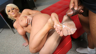 Were bringing you THE Milf of all Milfs-Alura Jenson. Alura is 44-30-44 and nothing gets her juices flowing like a big black cock. Aluras only using her 8.5 size feet to keep that big black cock hard and,so far,its mission accomplished. The busty,blonde c