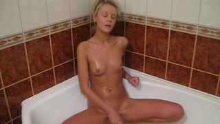 Yum what a hottie. This blonde girl with her dark eyes and tanned skin looks tasty. It's really hot watching her in the bathtub with her toy sucking on it before burying it deep in her slit then getting on her knees and fucking herself from behind.