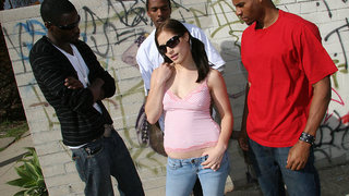 This scene starts out in the hood,in a back alley,to be specific. Three bruthas are hanging out wasting some time when a sexy white hot brunette walks through. She gives the first two the eye,and walks right up to the third,and asks if he is interested in
